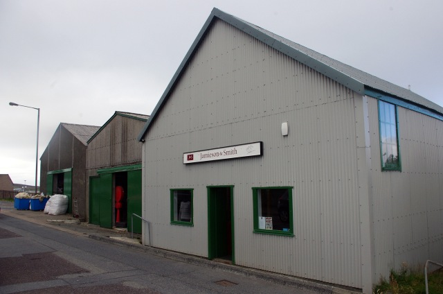 Under a typical Shetland summer sky, our big green doors are open all season to welcome in more wool at any time
