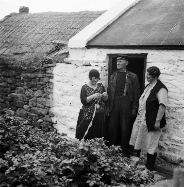 Teenie Gear, Jeemie Umphray (Ristie), Nurse Margaret Davidson. Teenie is knitting the border for a Shetland knitted lace shawl and using a knitting belt. Photo courtesy of the Shetland Museum and Archives